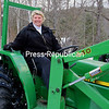 ALVIN REINER/P-R PHOTO 1-5-2017<br /> Anita Deming is just as comfortable and skillful piloting a farm tractor in a field as driving a car down the road.