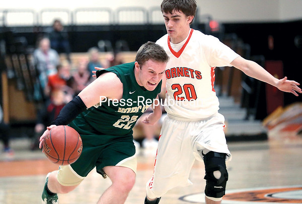 GABE DICKENS/P-R PHOTO 1-16-2017 Northern Adirondack's Bailey Cross attempts to drive past Plattsburgh High's Tyler Phillips during Thursday's Champlain Valley Athletic Conference boys basketball game at Plattsburgh High School.