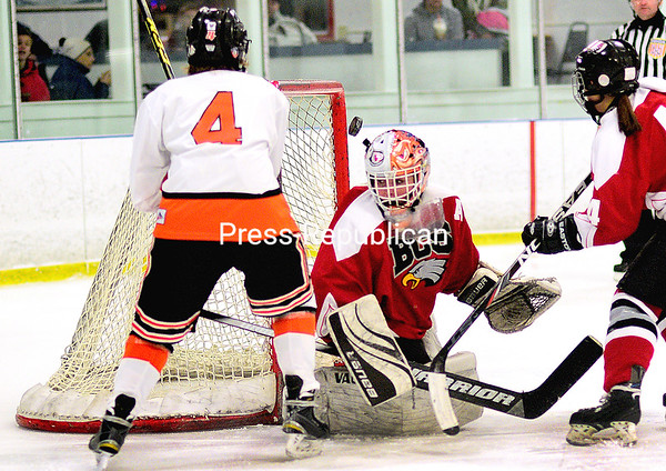 ROB FOUNTAIN/STAFF PHOTO 1-11-2017<br /> Beekmantown goalie Taylor Laurin (1) puts a stop to Plattsburgh High's Abby Hay's (4) shot Tuesday during Champlain Valley Athletic Conference girls hockey at Ameri-Can North Sports Center in Plattsburgh.
