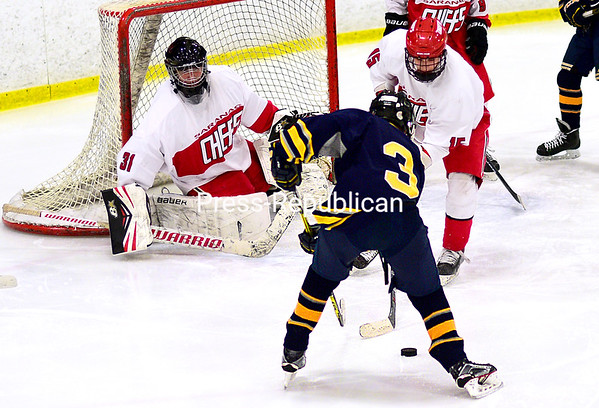 ROB FOUNTAIN/STAFF PHOTO 1-12-2017<br /> Lake Placid's Hunter Wilmot (3) looks to get by Saranac's Michael Prenoveau (15), with goaltender Konnor Shea looking on, during a Champlain Valley Athletic Conference boys hockey game Wednesday.