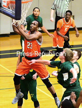 ROB FOUNTAIN/STAFF PHOTO 1-26-2017<br /> Clinton's Manny Overo (23) slices through Adirondack defenders to go in for a layup Wednesday during men's basketball action in Plattsburgh.