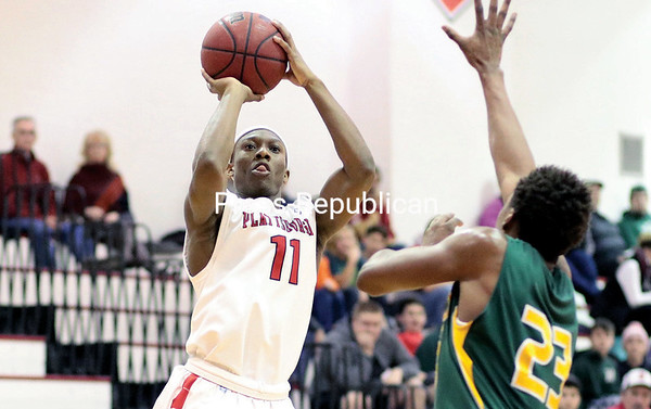 GABE DICKENS/P-R PHOTO 1-16-2017 Plattsburgh State's Brandon Johnson goes up for a 3-point attempt as Oswego's Keith Tyson tries to get a hand on the ball during Friday's State University of New York Athletic Conference match at Memorial Hall.