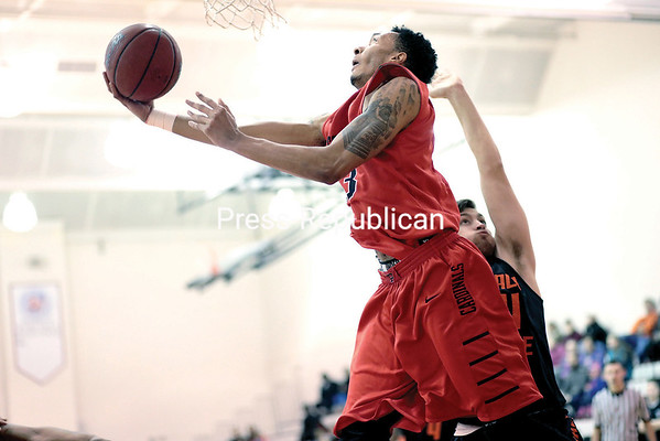 GABE DICKENS/P-R PHOTO 1-9-2017 Plattsburgh State's Eric Mack leaps past a Buffalo State defender during a SUNYAC men's basketball game Saturday at Memorial Hall.