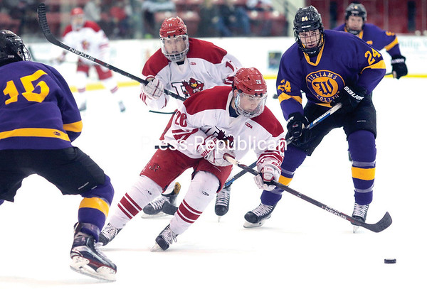 GABE DICKENS/P-R PHOTO 1-17-2017 Plattsburgh State's Ross Sloan carries the puck into the offensive zone during a non-conference men's hockey game against Williams Saturday at Stafford Ice Arena.