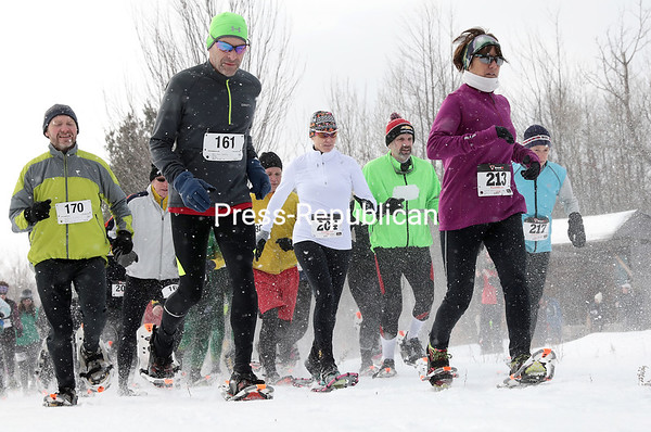 GABE DICKENS/P-R PHOTO 1-17-2017 Roughly 85 athletes turned out to compete in the annual Cock-A-Doodle-Shoe snowshoe race held recently at the New Land Trust in Saranac. The trust's 287 acres of forest and rolling hills provided the tracks for a 10K race, the Nicolas Pendl 5K and a half-mile kids snowshoe scramble. Pendl was a gifted snowshoer and member of the Paul Smiths Striders team who unexpectedly passed away in 2014. Proceeds from the races benefit the trust.