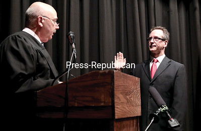 GABE DICKENS/P-R PHOTO 1-6-2017 City Court Judge Mark Rogers swears in Democrat Colin Read as the new mayor of the City of Plattsburgh Thursday evening in the City Hall Auditorium.