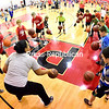 ROB FOUNTAIN/STAFF PHOTO 1-12-2017<br /> SUNY Plattsburgh women's basketball assistant coach Yazmin Lewis teaches kids dribbling techniques during the recent Basketball Skills Clinic held in Memorial Hall on campus. More than 150 kids came out to the free clinic, which was open to boys and girls of all ages and taught a variety of skills. The event was hosted by the Clinton County Youth Bureau, the Town of Plattsburgh Recreation Department and the college's women's basketball team.