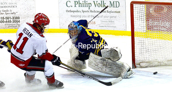 ROB FOUNTAIN/STAFF PHOTOS 1-19-2017<br /> Beekmantown's Keenan Regan (11) slips the puck past Lake Placid goaltender Kamm Cassidy (33) Tuesday at Stafford Ice Arena in Plattsburgh.