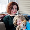 ROB FOUNTAIN/STAFF PHOTO 1-6-2017<br /> Author Aimée Baker sits with her daughter, Vivian Baker-Conners, on their porch at their home in West Chazy. Baker, a multi-genre writer whose work has appeared in the Southern Review, Gulf Coast, Guernica and the Massachusetts Review, was awarded the 2014 Zoland Poetry Fellowship from the Vermont Studio Center.