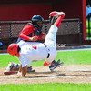 Plattsburgh RedBirds player Joseph Donaldson is tagged out at the plate while flipping over Puerto Rico Islanders catcher Joenny Vasquez.<br /> KAYLA BREEN/STAFF PHOTO
