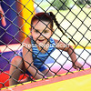 Gemma Matott, 3, excitedly leaps around inside the jump house at Chazy Old Home Day at Chazy Recreation Park on Sunday. Kids activities, put on by the Chazy Lions Club, featured wagon rides and carnival-style games.<br /> KAYLA BREEN/ STAFF PHOTO