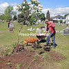 Darrell Altizer takes part in the annual cleanup day while his dog Sasha keeps him company at Peru Cemetery. Several volunteers participated as they trimmed trees, picked up brush and reset several headstones.<br /> JOANNE KENNEDY/P-R PHOTO