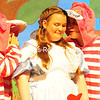 """Alice, played by Hayley Fountain, listens to two Cheshire Cats as they whisper in Alice's ear about the Queen of Hearts' favorite game during a rehearsal of """"Alice In Wonderland.""""<br /> KAYLA BREEN/STAFF PHOTO"""