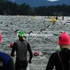 At the crack of dawn Sunday, contestants in the 2017 Lake Placid Ironman competition enter Mirror Lake as part of the race, which includes swimming, biking and a 26.2-mile run. Only their arms are visible as they swim the course. <br /> JACK LADUKE/ P-R PHOTO