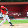 Plattsburgh RedBirds player D'Aundray Van Slyke swings and connects with the ball during Wednesday's Empire Professional Baseball League game against the Puerto Rico Islanders at Chip Cummings Field.<br /> KAYLA BREEN/ STAFF PHOTO