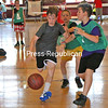 Wyatt LaBorde dribbles down the court as green-shirt players Joshua Gaboriault (middle) and Hayden Harvey (right) attempt to swipe<br /> the ball from him during the City of Plattsburgh Recreation Department's boys youth basketball camp at the city gym on the U.S. Oval. The week-long session for youths in grades 3 through 10 offers an opportunity to learn new basketball skills, play games and socialize with other kids. Each participant receives a T-shirt and a participation trophy. The girls week-long youth basketball camp begins July 17. Parents can register on the Plattsburgh Recreation Department website under Leagues and Programs.<br /> KAYLA BREEN/ STAFF PHOTO