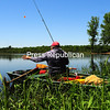 "KAYLA BREEN/ STAFF PHOTO<br /> Paul Marbut reels in his line after a successful morning of fishing at Ausable Marsh in Peru. ""I only caught one fish, but one is better than none,"" he said."