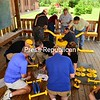 JACK LADUKE/ P-R PHOTO<br /> SUNY Technology Conference organizing committee members and attendees assemble a see-saw and Quatro playground equipment in Pawprint Park at Lake Placid Elementary School during the group's fifth-annual conference at the Conference Center at Lake Placid. The equipment was purchased as part of Project Playground, a professional development give-back campaign. This is the third time that the group has donated to the community while engaging in a team-building exercise. In past years, members undertook such projects as donating bicycles to area children and baskets of food to local residents. The SUNY Technology Conference welcomed more than 600 attendees and vendors June 19 through 22.