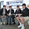 ALAN CARLON GOODMAN/ P-R PHOTOS<br /> Korean War veteran Robert Pelno (right) of Star Lake shares a memory with (from left) Morris Reed of Russell, Lawrence Reed of Potsdam and Douglas Pilon of Chazy as they await the boarding of North Country Honor Flight One at Plattsburgh International Airport Saturday morning. The Reed brothers served in World War II, Morris in the Navy as a shipfitter on a destroyer in the Pacific Ocean during the occupation of Japan, and Lawrence in the Army as a telephone lineman on the Korean peninsula. Both Pelno and Pilon served as machinist mates in the Navy, Pelno on the destroyer John R. Craig patrolling the Strait of Formosa during the Korean War, and Pilon on an ammunition carrier in the waters off Southeast Asia during the Vietnam War. The quartet joined 10 other veterans on the 19th North Country Honor Flight, an all-expenses-paid trip to the war memorials in Washington, D.C.