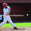 KAYLA BREEN/ STAFF PHOTO<br /> Plattsburgh RedBirds catcher Damon DeJesus swings and connects during an Empire Professional Baseball League game against the Puerto Rico Islanders Wednesday at Chip Cummings Field.
