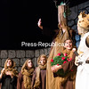 """GABE DICKENS/ P-R PHOTO<br /> King Arthur, played by Matt Tetreault, presents the knights Who Say """"Ni"""" with a shrubbery to gain passage through the forest in the scene """"Always Look on the Bright Side"""" during the Clinton Community College Drama Club's presentation of """"Monty Python's Spamalot"""" in the Forrence Center auditorium on campus."""