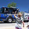 KAYLA BREEN/ STAFF PHOTOS<br /> Jordanne Minchoff, 3, and her brother Brady, 2, move their arms in a honking fashion at the Peru Fire Department firetruck, urging firefighters to honk their horn during Sunday's 51st-annual Cadyville Fire Department Field Day and Parade.
