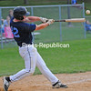 KAYLA BREEN/ STAFF PHOTO<br /> Clinton County Sr. Mariners player Brady Pennington connects on a pitch during Monday's American Legion baseball game against the Peabody's Padres at Lefty Wilson Field in Plattsburgh.