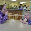 JOANNE KENNEDY/ P-R PHOTO<br /> Two-year-old Charley Seguin enjoys a soft ice cream with her mom, Jenna Seguin, at Sweet Treat Ice Cream at 2897 State Route 22 in Peru. The shop recently purchased by Peru residents, Tim and Jeanne Arnold. Jeanne is following her parents' footprints, as in 1964 Joseph and Cynthia Ondrek also owned an ice cream shop in Peru. That one was called Jeanne's Dairy Bar.