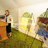 JACK LADUKE/ P-R PHOTO<br /> At groundbreaking ceremonies Thursday, Adirondack Health President and Chief Executive Officer Sylvia Getman gestures toward a graphic of an indoor swimming pool that will be included in the new $13.9 million Lake Placid Health and Medical Fitness Center, to be built near the Uihlein Living Center nursing home in Lake Placid. It will house an emergency department, a state-of-the-art rehabilitation suite and medical offices.