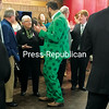 SUZANNE MOORE/ STAFF PHOTO<br /> Adam Crosley of Plattsburgh shares his St. Patrick's Day excitement with the many in attendance at Friday morning's Irishman of the Year event. Crosley said he found his colorful suit online.