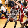 ROB FOUNTAIN/ STAFF PHOTOS<br /> Willsboro's Warren Jackson (3) looks for room under the basket against Schroon Lake's Gabe Gratto (23) Wednesday during a Section VII Class D semifinal in Clintonville.