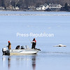 ROB FOUNTAIN/ STAFF PHOTO<br /> Fishermen look for nibbles in the icy waters of Lake Champlain near Wilcox Dock in Plattsburgh. Fishing season for rivers and streams opens on April 1.