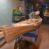 JOANNE KENNEDY/ P-R PHOTO<br /> Retiree Bob Rusnak works on a modified Wee Lassie cedar-strip canoe for his daughter, Amy Rusnak. He is doing much of the boat by hand, as he finds it more soothing than the loud noise of electrical saws and sanders. The Schuyler Falls resident guesses he has about 120 hours invested in the boat and that three-quarters of the work is complete.