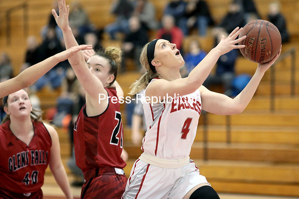 GABE DICKENS/ P-R PHOTO<br /> Beekmantown's Kenna Guynup darts past Glens Falls' Lucy Tougas for a layup during an NYSPHSAA girls basketball Class B regional Saturday at the Plattsburgh State Field House.