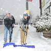 JACK LADUKE/ P-R PHOTO<br /> Bill Hynes (left) and Steve Ragusa of Saranac Lake shovel off the sidewalk in front of High Peaks Cyclery in Lake Placid as snow falls around them. Stella socked the region, starting Tuesday morning and continuing into today.