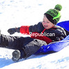ROB FOUNTAIN/ STAFF PHOTO<br /> Braiden Rivers cruises down a snow-covered hill at South Platt Park in Plattsburgh, enjoying himself while trying to stay on the sled. Temperatures this week are going to shift as fast as sled does, with bitter cold today and upper 30s by Friday.