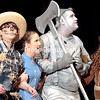 """GABE DICKENS/ P-R PHOTO<br /> Scarecrow, Dorothy, Tinman and Lion — played by T.J. Miner, Lydia Aierle, Pacey Couture and Teddy Defayette — encounter unusual happenings as they await the arrival of The Wiz during Saranac Central Drama Club's presentation of """"The Wiz,"""" based on the story """"The Wonderful Wizard of Oz"""" by L. Frank Baum, at Saranac Central School Friday evening. The final performance takes place at 2:30 p.m. today. Tickets are $8 in advance and $10 at the door."""