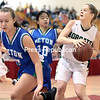 GABE DICKENS/ P-R PHOTO<br /> Northern Adirondack's Danya Burl fakes out Seton Catholic's Cailene Allen (left) by slamming on the brakes as her teammate Rachel Racette comes in from behind to guard Burl during Friday's Section VII Class C championship game at the Field House in Plattsburgh.