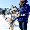 JACK LADUKE/ P-R PHOTO<br /> John Houghton of Vermontville pets his lead dog, Lucky, before taking visitors to Lake Placid on a tour around Mirror Lake. Houghton has been giving sled-dog rides to the public for the past 28 years. He said a warm winter last year cut down on his business, but colder weather this year has brought a return to normal. Houghton recently flew to Alaska to help Peter Reuter, also of Vermontville, prepare for the grueling, long-distance Iditarod sled dog race.