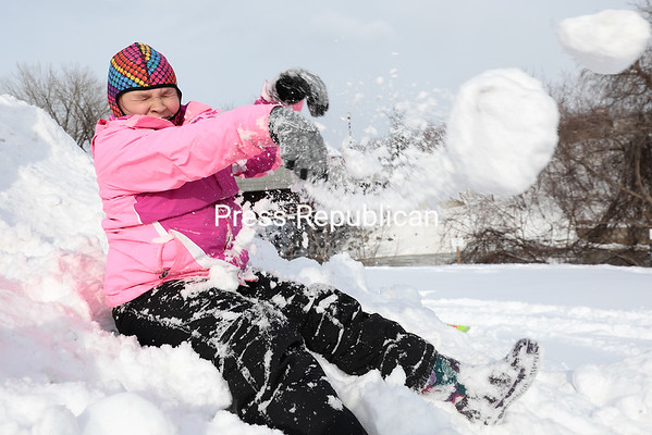 GABE DICKENS/ P-R PHOTO<br /> Isabella Brodi, 10, braces for a potential impact after hurling a snowball at a family member in Plattsburgh Wednesday.