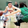 GABE DICKENS/ P-R PHOTO<br /> Beekmantown's Kenna Guynup dribbles toward a Seton Catholic Central defender during a NYSPHSAA Class B girls basketball semifinal at Hudson Valley Community College in Troy.