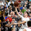 ROB FOUNTAIN/ STAFF PHOTOS<br /> Moriah's Andrew Snyder (24) goes for a layup over the top of Crown Point's Chad Stephens (14) Wednesday during a Section VII Class D semifinal in Clintonville.