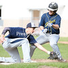 GABE DICKENS/ P-R PHOTO<br /> AuSable Valley's Eric Pothast tags out Lake Placid's Colin Hayes at third base during Thursday's Champlain Valley Athletic Conference baseball game at AuSable Valley Elementary School.