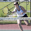 GABE DICKENS/ P-R PHOTO<br /> Lake Placid's Aimee Hebert returns the ball during a doubles match with teammate Karli Casler during a tennis match against Seton Catholic Friday at Macdonough Courts in Plattsburgh.