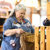 KAYLA BREEN/ STAFF PHOTO<br /> Jane Desotelle begins to set up her vendor booth, Underwood Herbs, at the Plattsburgh Farmers and Crafters Market. Along with vendors, the market is planning to host a number of entertainers, Master Gardeners and a Kids Day.