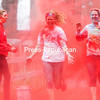 GABE DICKENS/ P-R PHOTO<br /> Christina Regina (left) and Melanie Taylor receive a shower of crimson-colored cornstarch as they make their way down the Saranac River Trail in Plattsburgh on the home stretch of the third-annual Autism Speaks U SUNY Plattsburgh 5K Color Run, featuring support by the women's soccer team. Autism Speaks U, an initiative of Autism Speaks, promotes awareness, advocacy and supports fundraising efforts for college students and faculty to help individuals and families affected by autism.