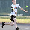 GABE DICKENS/ P-R PHOTO<br /> Plattsburgh High's Brendan Whalen sprints to return the ball to his opponent, Alex Rine of Peru, during the boys singles championship match at Plattsburgh High Friday.