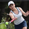 GABE DICKENS/ P-R PHOTOS<br /> Lake Placid's Sonja Toishi fires the ball back to her opponent during the Section VII girls singles championship match against Plattsburgh High's Brina Micheels at the Macdonough Courts in Plattsburgh Friday.