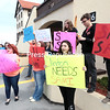 GABE DICKENS/ P-R PHOTO<br /> About 15 Clinton Community College students rally in front of the Moore Academic and Administrative Building Thursday morning to protest the layoff of assistant professor Sami Jeskanen, a teacher in the college's History, Political Science, Economics and Geography Department.