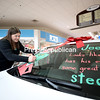Shana Kirk finishes painting a smirking Grinch on the windshield of a Durocher Jeep Cherokee inside the Champlain Centre mall in Plattsburgh. It took Kirk about an hour to complete the promotional artwork.<br /> KAYLA BREEN/ STAFF PHOTO